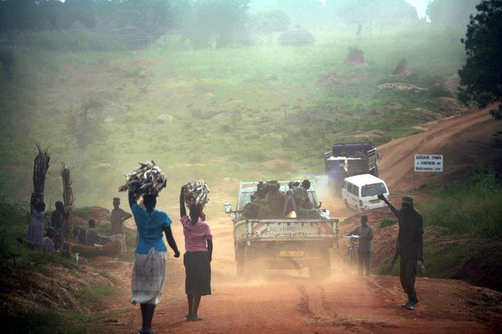 Ugandans internally displaced by fighting in November 2005 fetch water and firewood near Kitgum in the...
