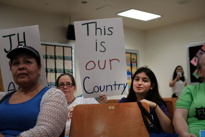 Some of Ocasio-Cortez's diverse constituents brought homemade signs to an immigration town hall on