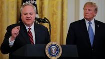 President Donald Trump listens to U.S. Interior Secretary David Bernhardt speak during an event touting...