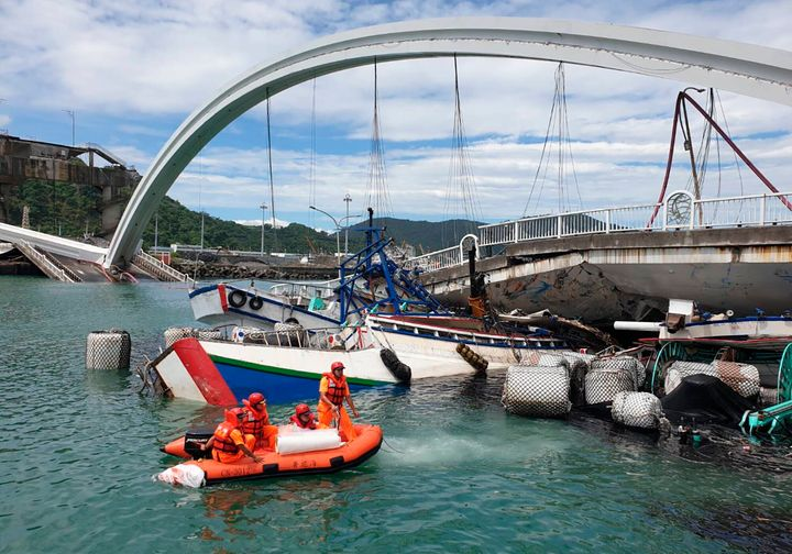 Rescuers work near the site of a collapsed bridge in Nanfangao, eastern Taiwan. Tuesday, Oct. 1, 2019.