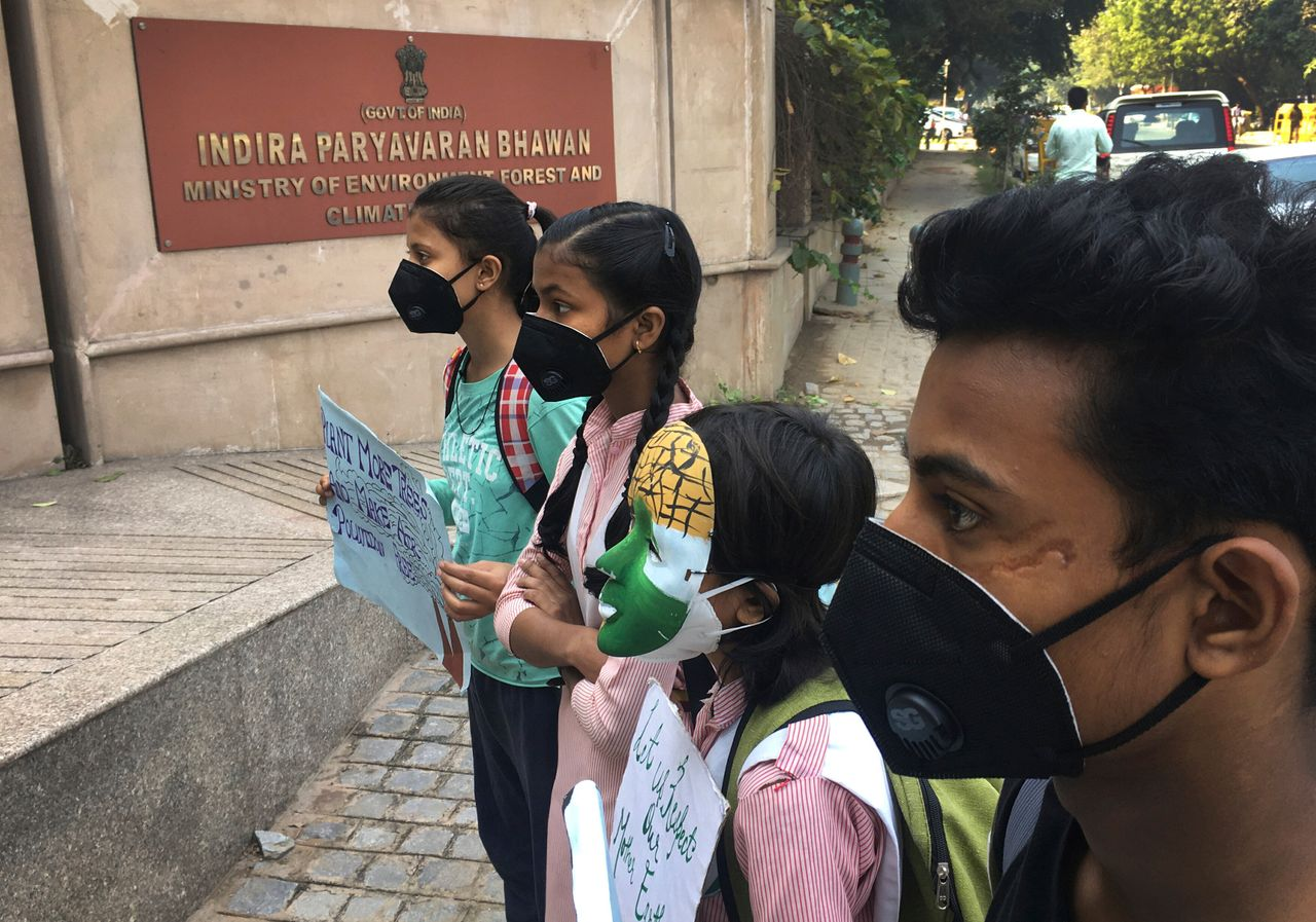 Schoolchildren protest outside the Indian Environment Ministry against alarming levels of pollution in...