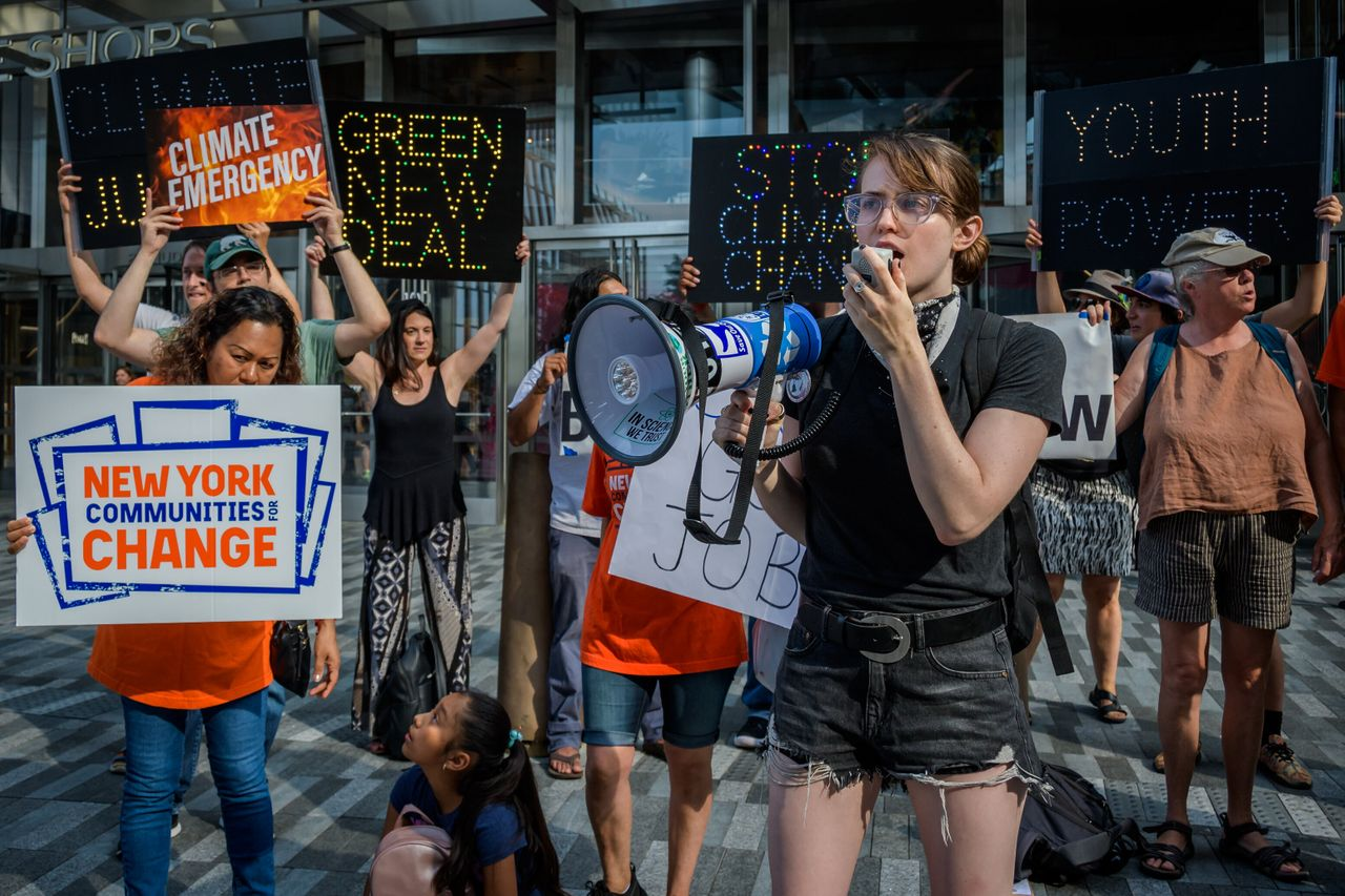 Hundreds of climate activists gathered outside CNN studios on Sept. 4, 2019, before the presidential...